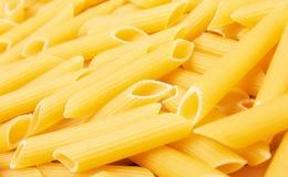 Penne italian pasta background Royalty Free Stock Photos