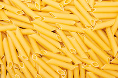 Penne italian pasta background Stock Photography