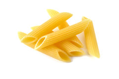 Penne, italian raw pasta, white background Royalty Free Stock Photos