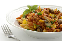 Penne with Italian sausage and mushrooms Stock Photos