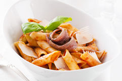 Penne lisce with anchovy. And tomato sauce Stock Image