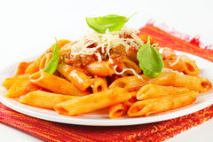 Penne with meat tomato sauce Stock Images