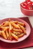 Penne med tomatsås och ny röd peppar Fotografering för Bildbyråer