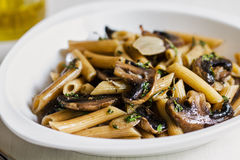Penne with mushroom and herb sauce Royalty Free Stock Images