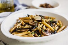 Penne with mushroom and herb sauce Stock Photo