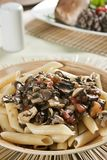 Penne with mushroom sauce. Stock Images