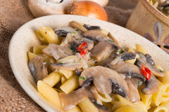 Penne and mushroom sauce stock photography