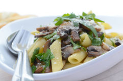 Penne with mushrooms and rucola Stock Photo
