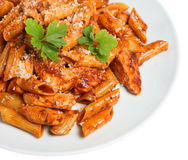 Penne Pasta. With chicken pieces in a sun-dried tomato and olive sauce Stock Images