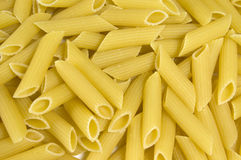 Penne Pasta. Background of uncooked penne pasta Stock Photo