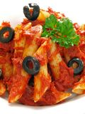 Penne pasta. In tomato sauce on a plate closeup Stock Photo