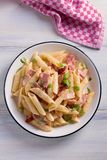 Penne pasta with bacon and sundried tomatoes. View from above, top studio shot Stock Images