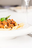 Penne Pasta with Bolognese Sauce half plate Royalty Free Stock Photo