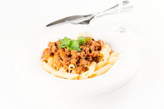 Penne Pasta with Bolognese Sauce knife Royalty Free Stock Photo
