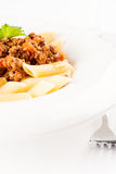 Penne Pasta with Bolognese Sauce vertical macro Royalty Free Stock Photography