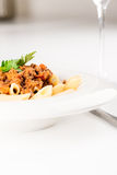 Penne Pasta with Bolognese Sauce vertical Stock Photography