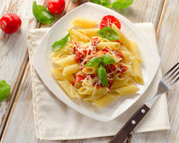 Penne pasta with   bolognese  sauce on a  white wooden  table Stock Photos