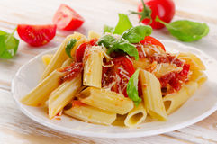 Penne pasta with a  bolognese  sauce on the white wooden  table Stock Image