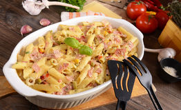 Penne pasta casserole with cheese Stock Image