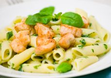 Penne pasta with chicken breast and pesto sauce Stock Photo