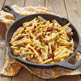 Penne pasta with chicken and cream sauce Stock Photo