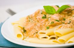 Penne pasta with chicken meat, cream sauce Stock Image