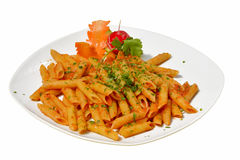 Penne pasta with chili sauce arrabiata on white background stock photography