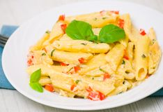 Penne pasta with cream sauce Stock Images