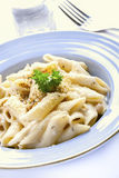 Penne pasta cream sauce. And cheese stock photo