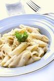 Penne pasta cream sauce Stock Photo