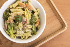 Penne Pasta dish with broccoli. Cheese sauces and penne pasta with prosciutto and broccolis Royalty Free Stock Images