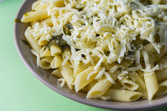 Penne pasta food dish on a green background Royalty Free Stock Photo