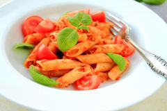Penne pasta with fresh basil Stock Image