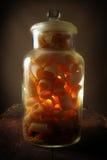 Penne pasta in glass jar stock photo