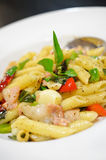 Penne pasta with ham and basil, Italian food. Stock Images