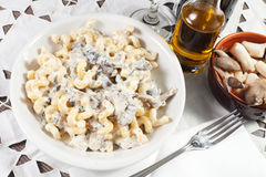 Penne pasta with mushroom and basil Royalty Free Stock Photography