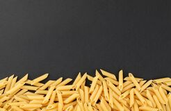 Free Penne Pasta On Black Background Royalty Free Stock Image - 181448546