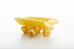 Penne pasta på vit bakgrund Royaltyfria Bilder