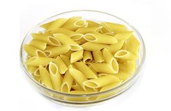 Penne pasta in bowl on white background royalty free stock images