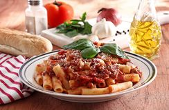 Penne pasta. With red sauce in kitchen table Stock Image