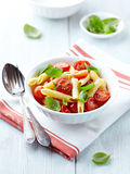 Penne pasta with roasted cherry tomatoes Stock Photos
