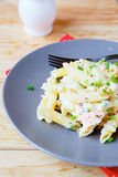 Penne pasta with salmon Stock Photo