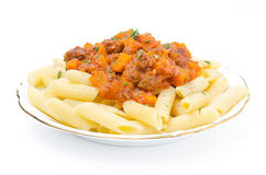 Penne pasta with sauce of beef, tomato and pumpkin isolated Royalty Free Stock Photography