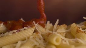 Penne pasta with sauce stock footage