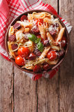 Penne pasta with sausage, leeks, cheese and tomato. vertical top Royalty Free Stock Photo