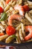 Penne pasta with shrimp, tomato and pesto macro. Vertical Royalty Free Stock Photo