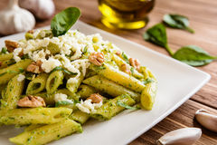 Penne pasta with spinach pesto, walnuts and mozzarella Stock Photography