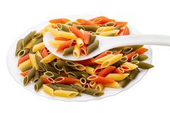 Penne pasta in spoon and plate Stock Images