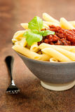 Penne pasta with a tomato bolognese beef sauce Stock Photo