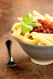 Penne pasta with a tomato bolognese beef sauce Stock Images